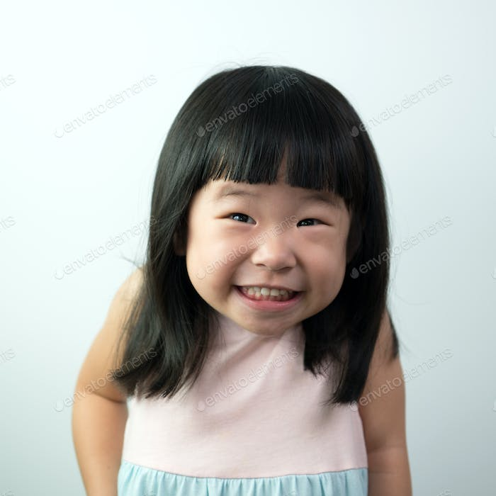 Happy little girl with funny face