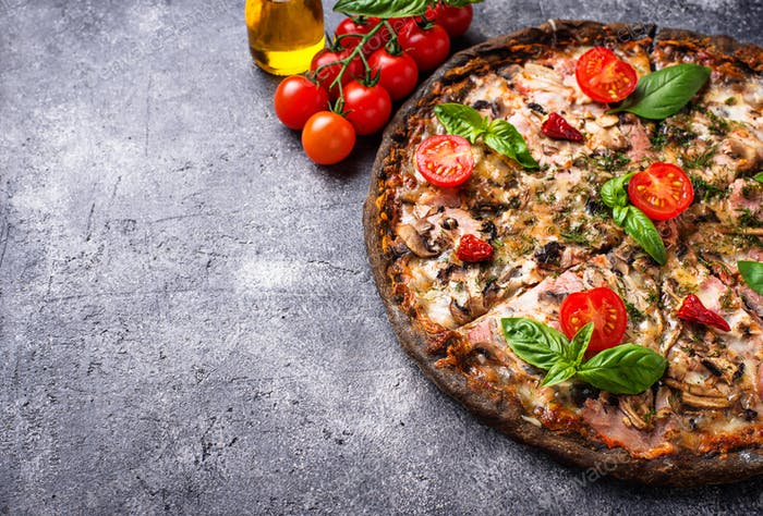 Italian pizza on black dough. Trendy food