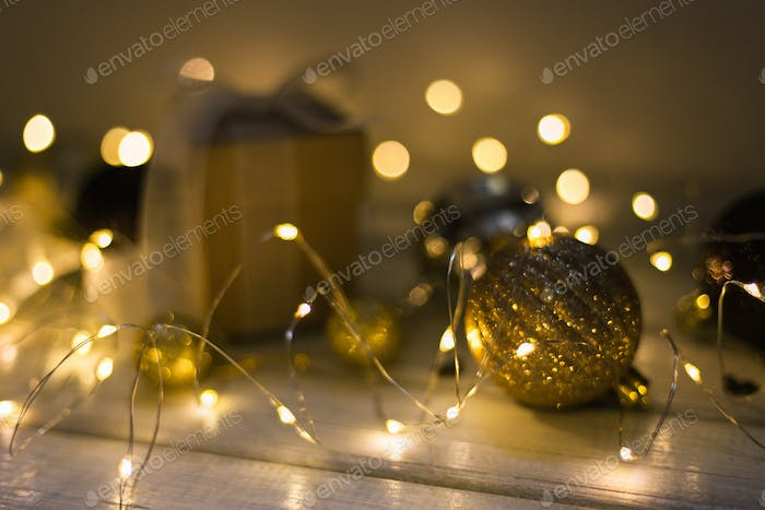 Christmas decoration with fir tree, gift box, garland lights, toys. Winter holidays, Merry Christmas