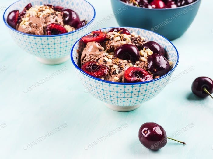 Chocolate ice cream sundae with cherries
