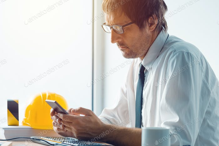 Architect and construction engineer working in office