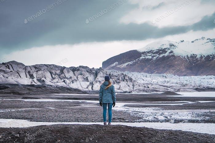 Woman standing enjoying snowy mountains view