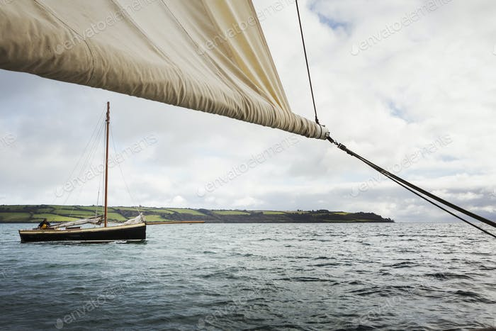 Traditional Sustainable Oyster Fishing. Traditional sailing boats on the water.