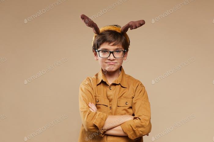 Boy wearing Antlers in Studio