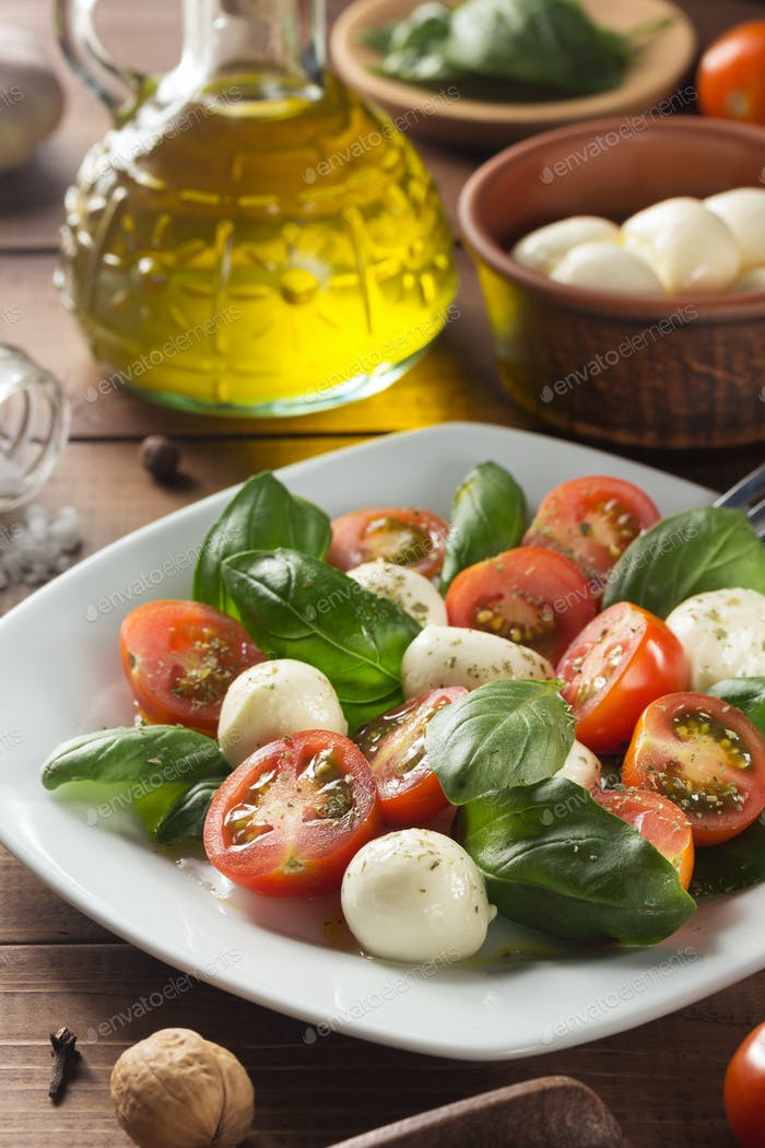 caprese salad in plate at wood