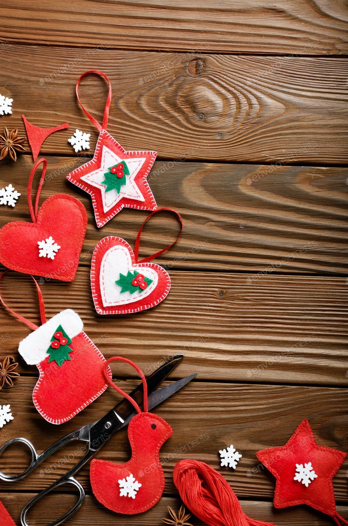 Handmade rustic Christmas tree decorations with scissors and ani