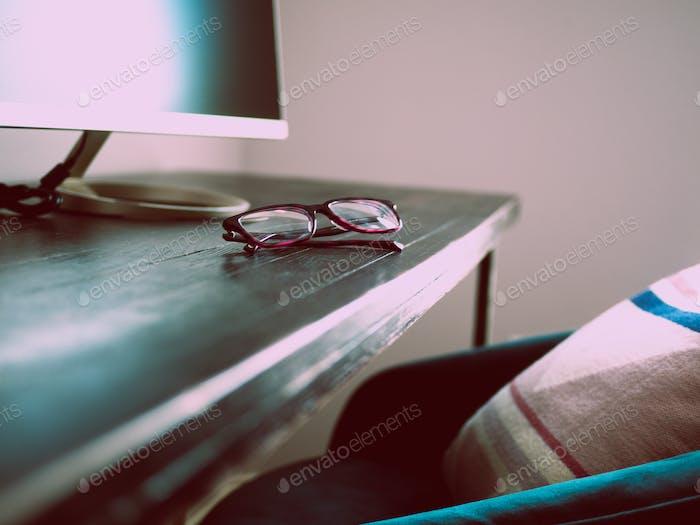 Glasses on a desk