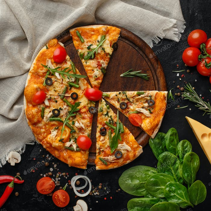 Sliced Pizza With Cherry Tomatoes And Rocked Salad