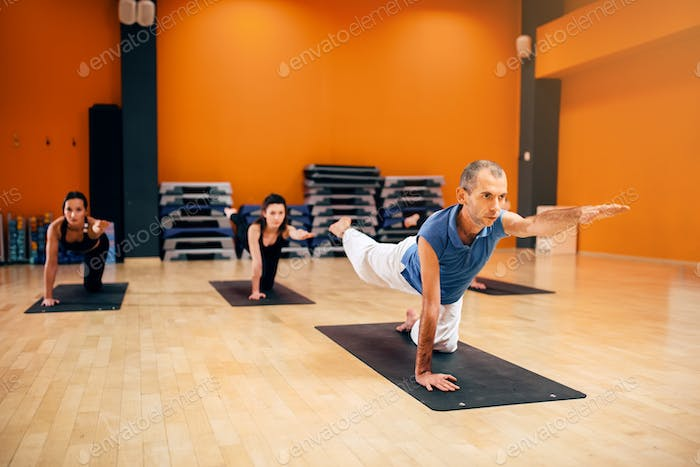 Yoga stretching training, group with instructor
