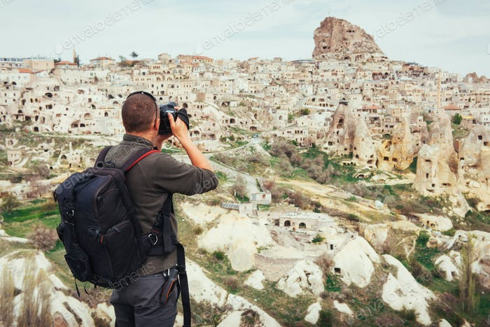 man photographs the ancient city