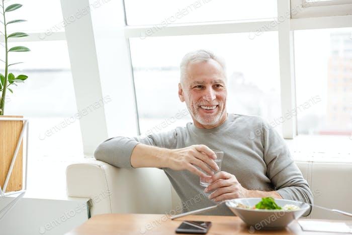 Senior grey-haired bearded businessman