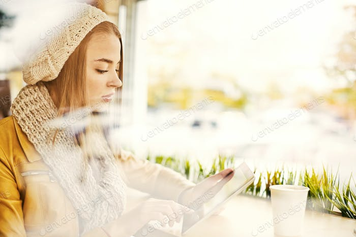 Young Woman Waiting in Coffee Shop