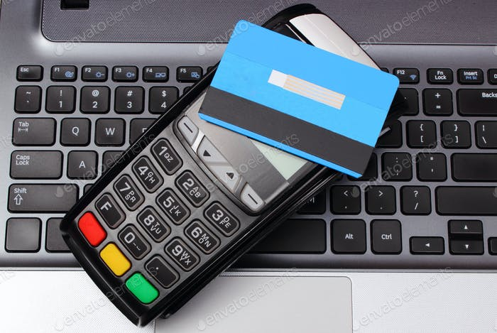 Payment terminal with contactless credit card and laptop
