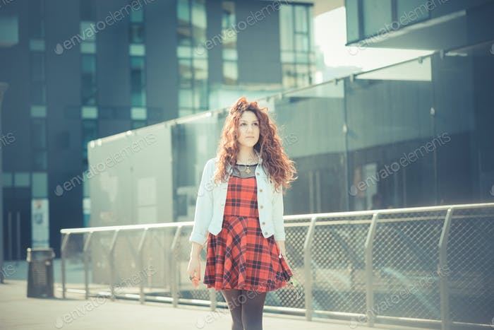 Thumbnail for young beautiful hipster woman with red curly hair