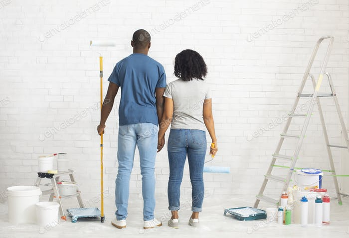 African american couple with paint and instruments, planning home repair