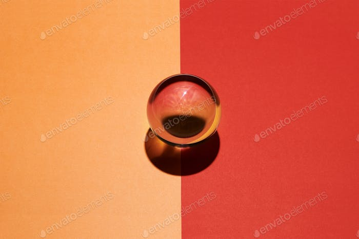 Glass sphere on a divided orange and red