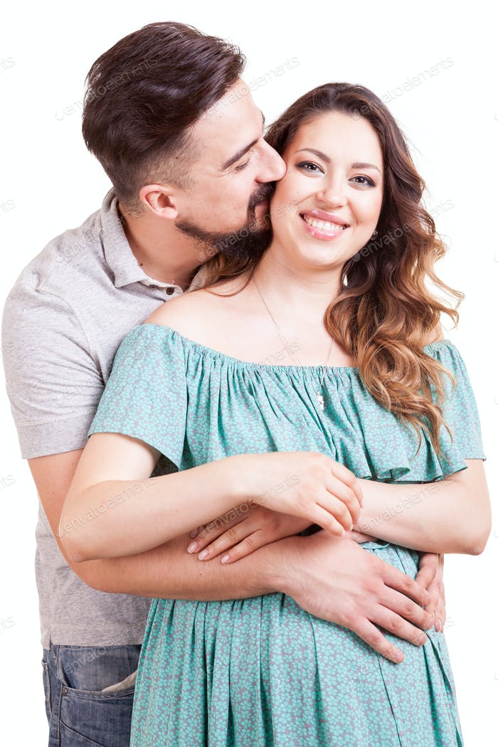 Happy Pregnant woman with her partner in studio photo