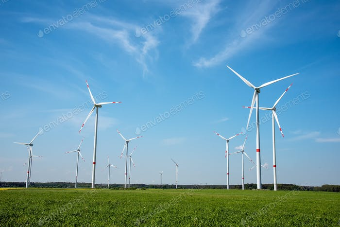 Modern wind energy generators on a sunny day