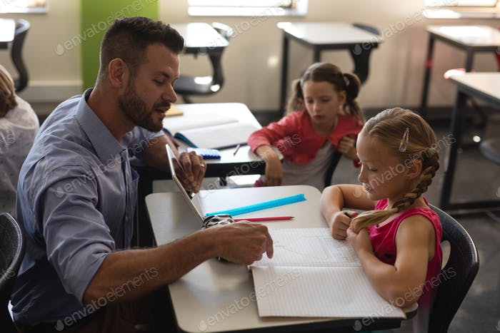 Young teacher helping girl