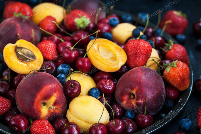 Fresh ripe summer berries and fruits