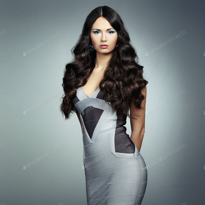 Fashion photo of young magnificent woman in gray dress