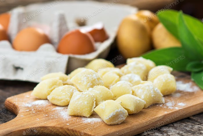 Uncooked homemade gnocchi on  cutting board