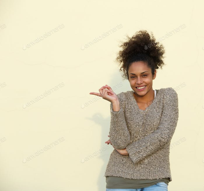 Happy african american woman pointing finger