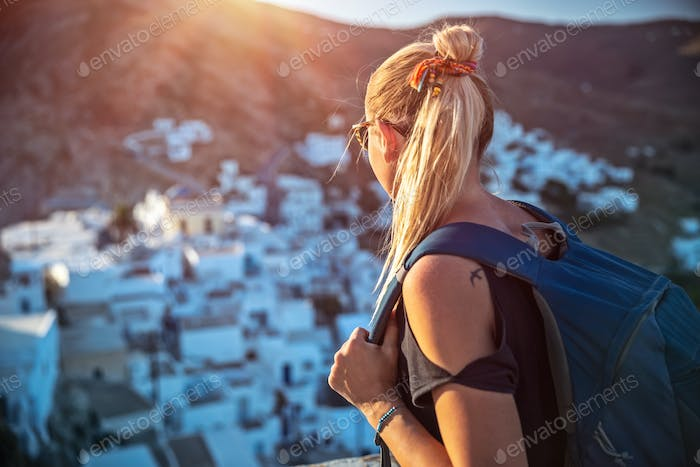 Traveler girl enjoying mountainous village view