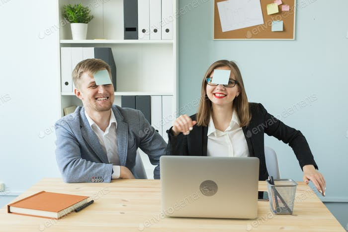 Business, break and people concept - Cheerful man and woman playing games in office while working