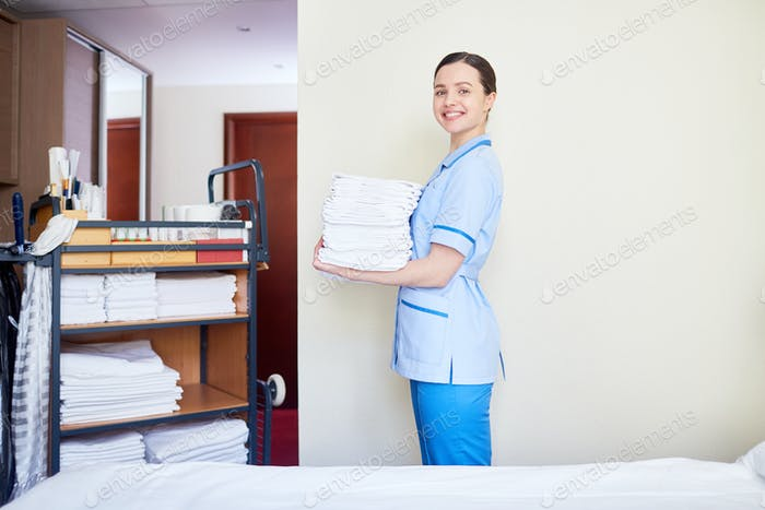 Chambermaid with towels