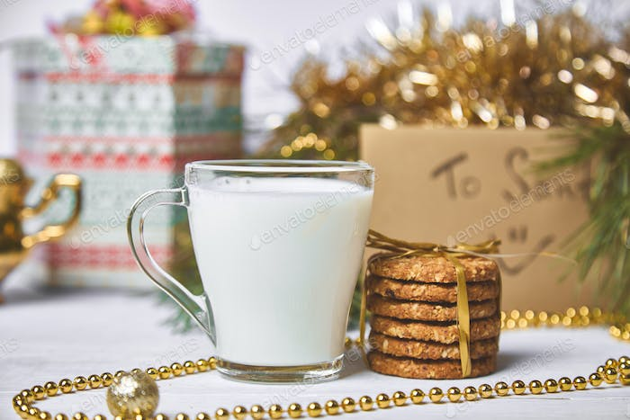 Christmas glass with milk and cookies For Santa on the table