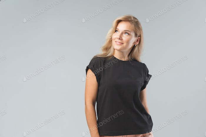 Blonde beautiful woman in black T-Shirt. Studio shoot