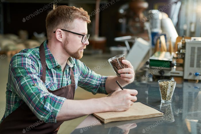 Barista Examining Coffee Roast