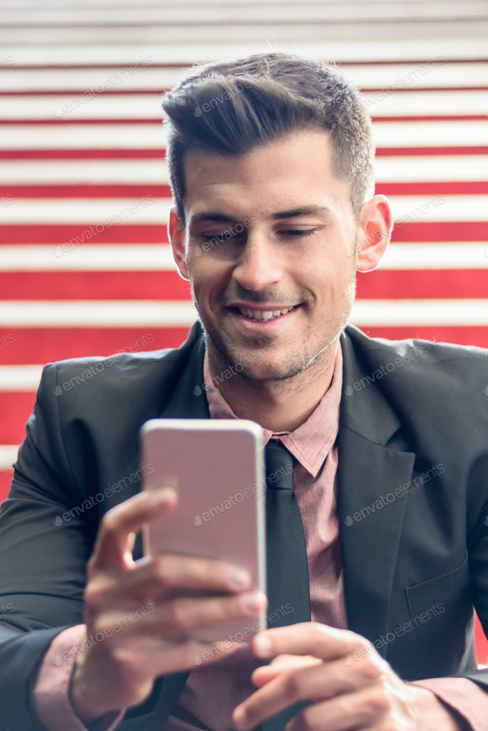 man close up with a mobile phone