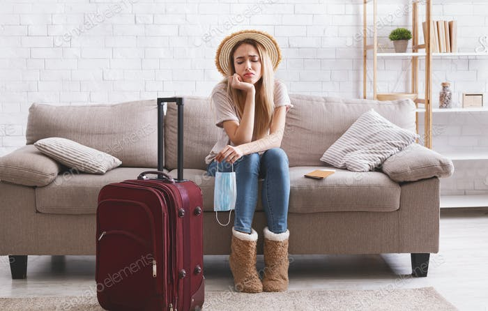 Travel cancel and sad woman stay at home