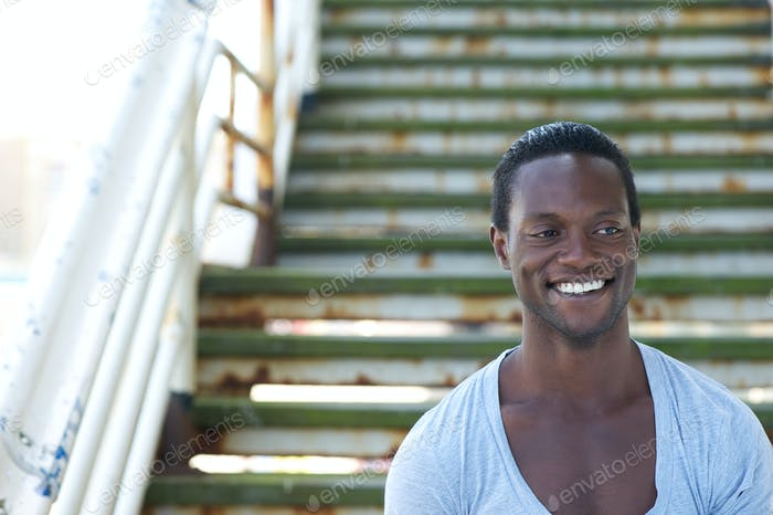 African american male model smiling outdoors
