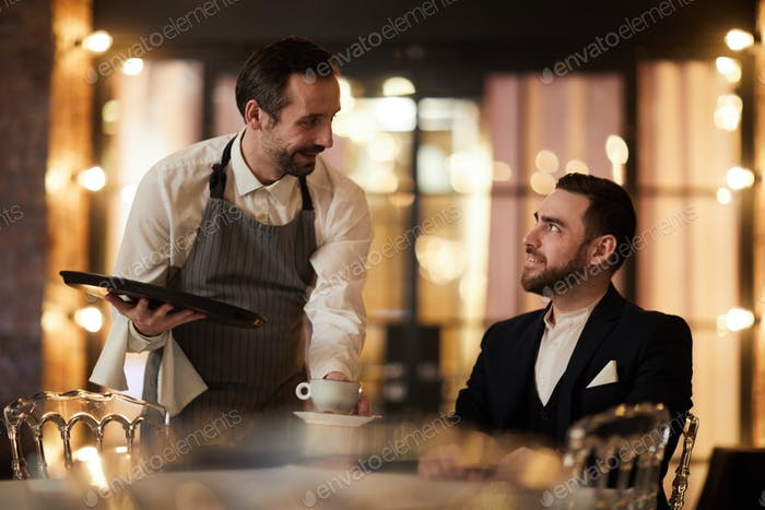 Waiter Bringing Coffee to Guest
