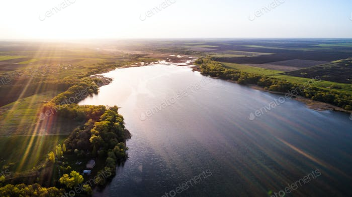 Sunrise over a beautiful river from a bird's eye view
