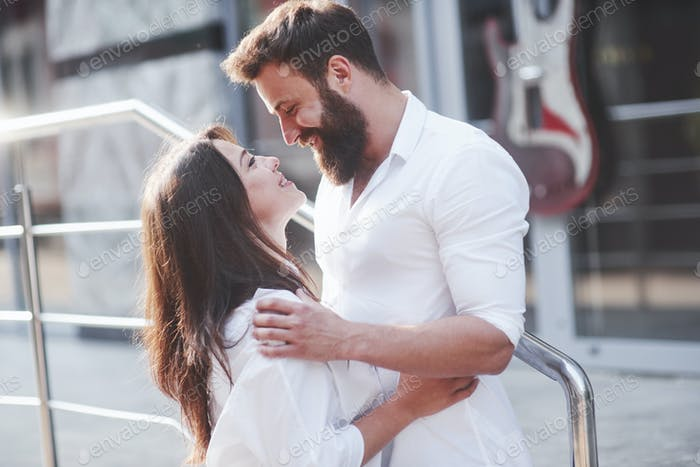 Beautiful happy couple hugging on the city street.Lifestyle concept love and romance