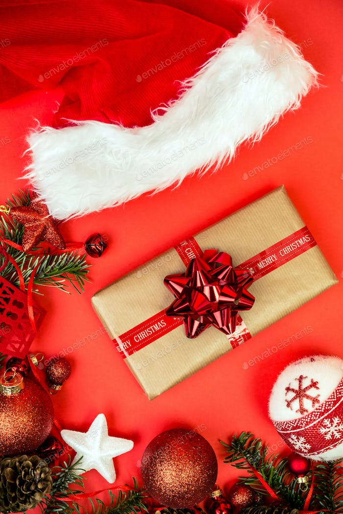 Christmas red background with fir tree, red christmass balls.