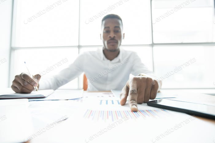 Concentrated financial advisor examining papers