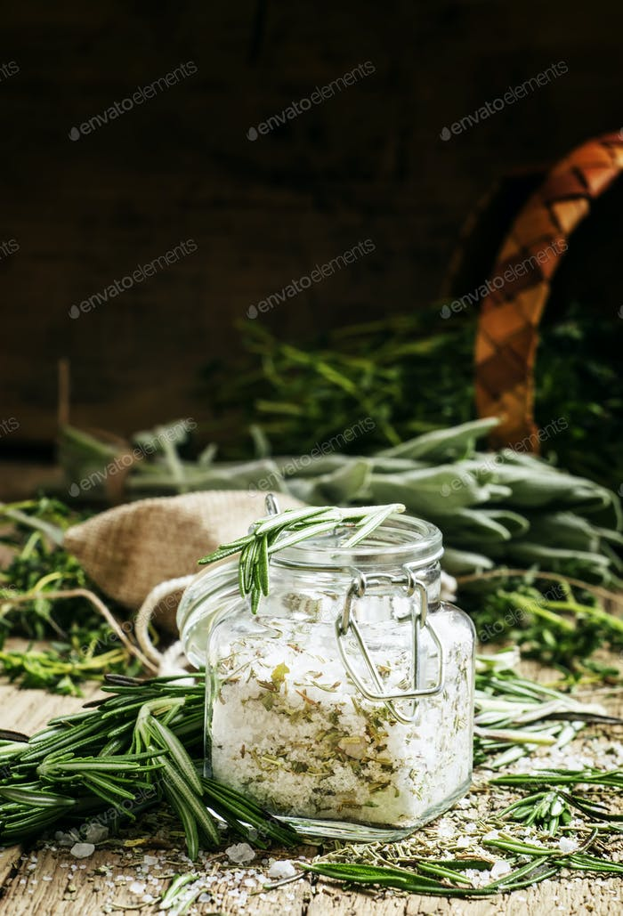 Sea salt with dried rosemary in a glass jar