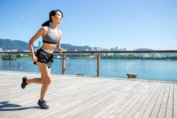 Woman practice running in the morning