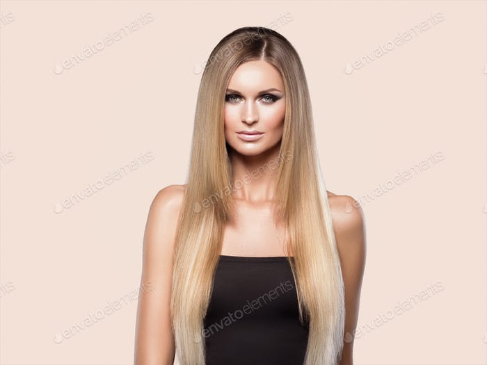 Woman smooth hair blonde lond beauty natural casual portrait. On beige.