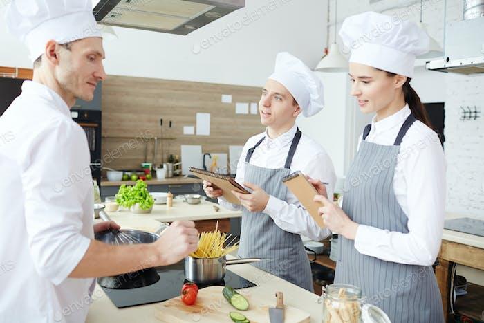 Creating menu at restaurant kitchen