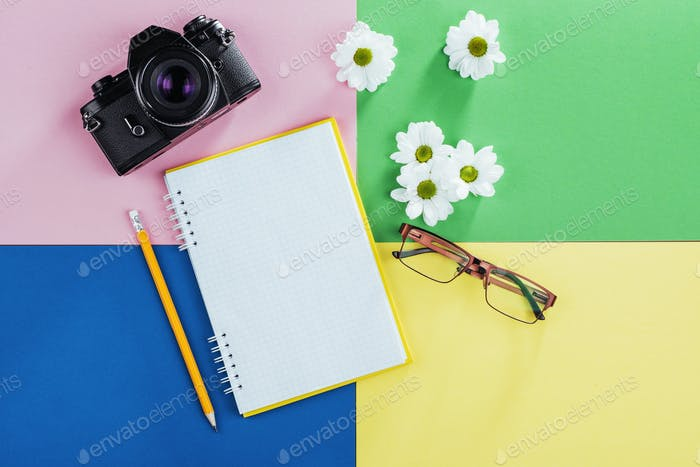 notebook, pencil, glasses, coffee and fragrant white flowers.