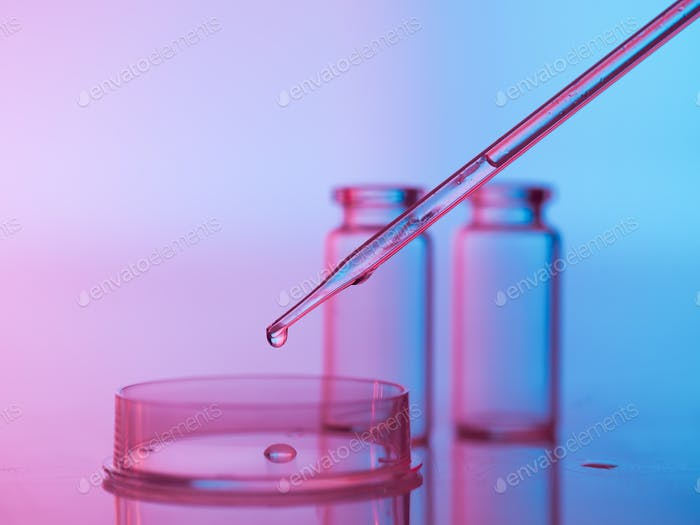 laboratory glassware with tranparent liquid in pipette