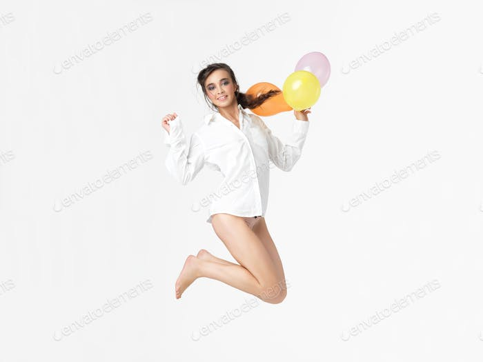 happy woman with balloons, isolated white background