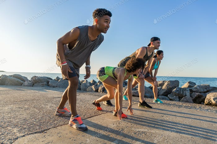 Group of sporty people getting ready to run a marathon