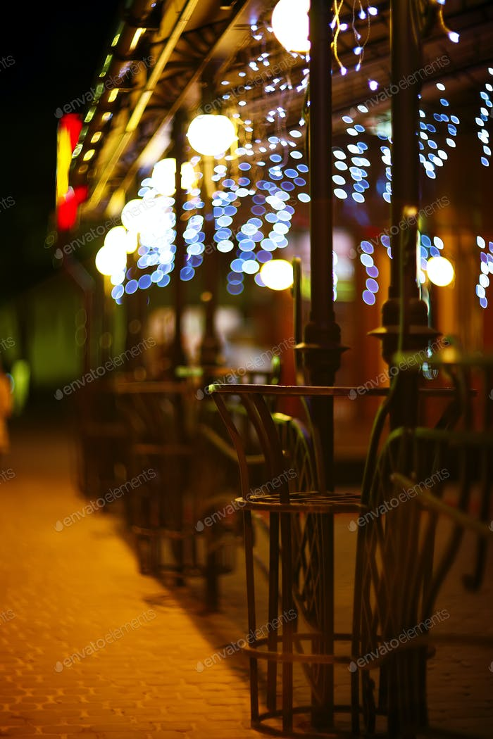 Fences and blurred night lights decorations of the bar on backgr